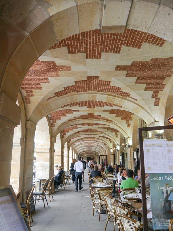 Vaulted arches in Place des Vosges, Le Marais