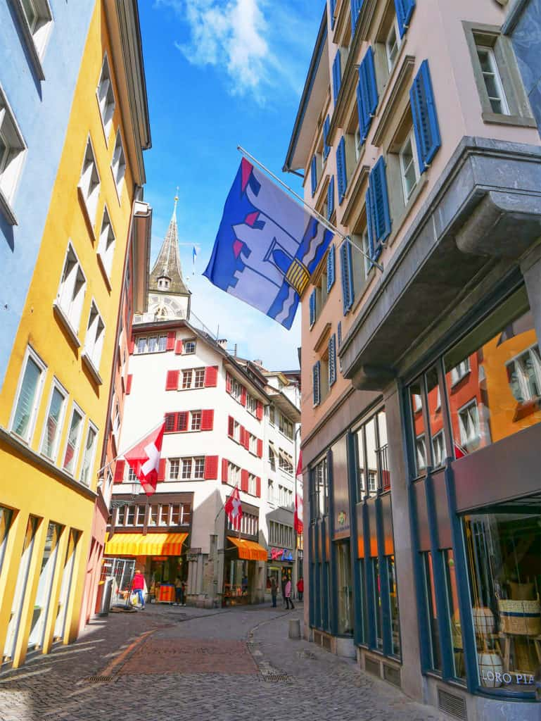 Colourful flags in the Altstadt of Zurich, Switzerland - read our suggestions on the best things to do in Zurich on Luxurycolumnist.com