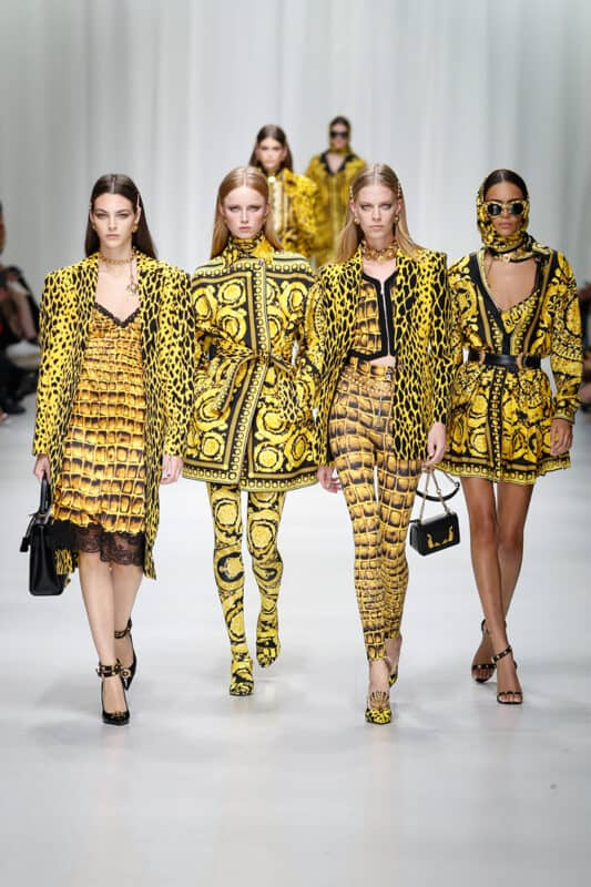 Models walk the runway at the Versace show during Milan Fashion Week - the most expensive clothing brands in the world