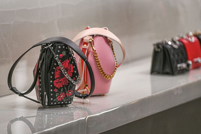 Alexander McQueen hand bags in a Paris store